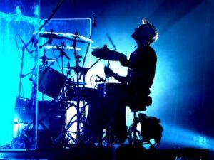 Drummer playing drum kit